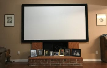 Projector in a living room screen.