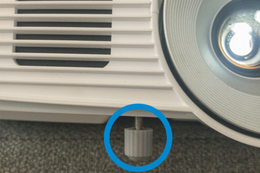 Adjust the Image on a Projector by screwing or unscrewing the feet