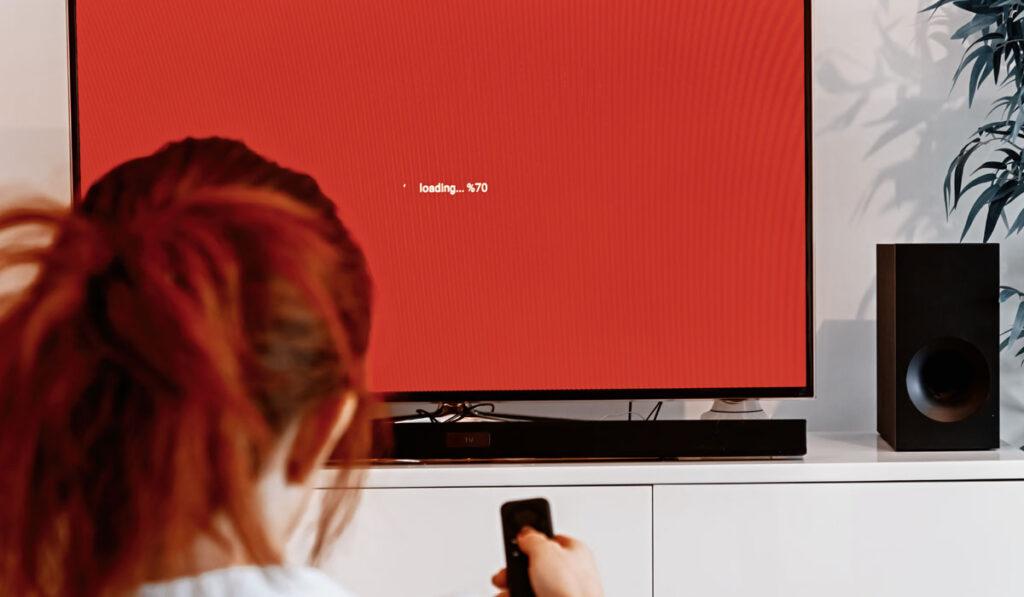 Woman controlling a soundbar and tv