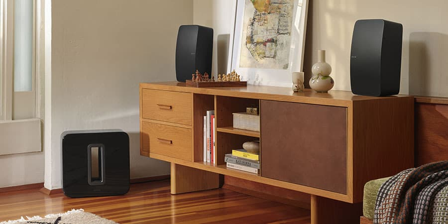 Pair of Sonos Five Speakers and Sonos Sub in a room.