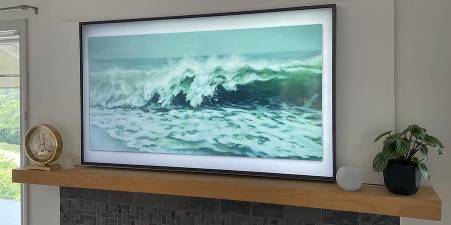 Apple HomePod Mini next to Samsung The Frame TV