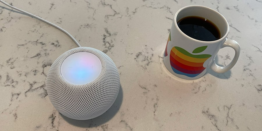 Apple HomePod Mini on a Kitchen Counter with Apple Mug