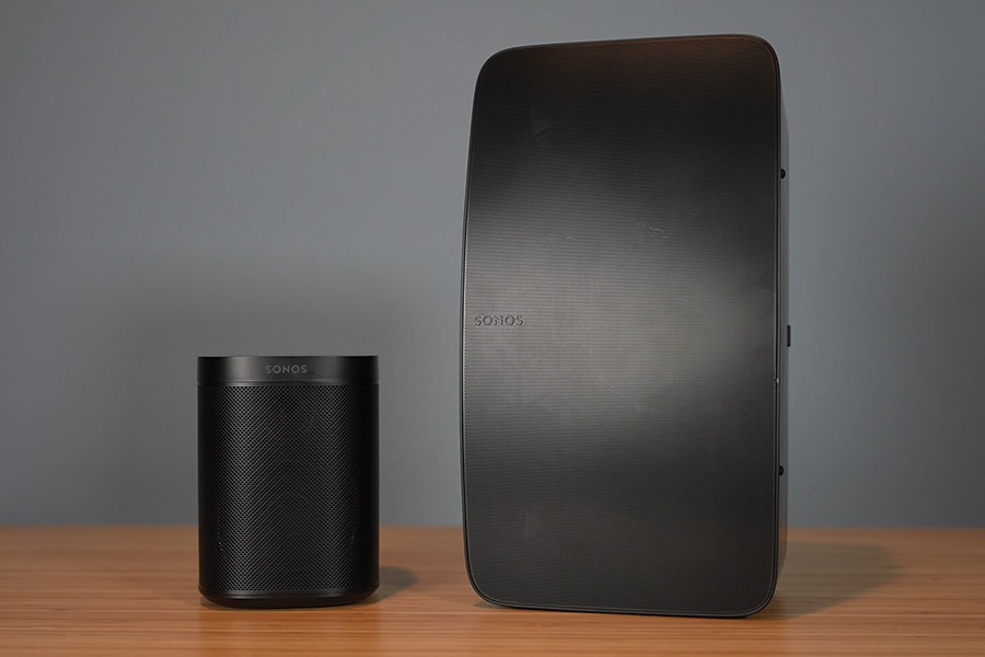 Sonos One SL and Sonos Five Speakers on a Bamboo Desk
