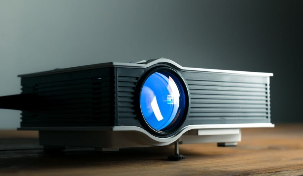 Small Projector with dark wall in background
