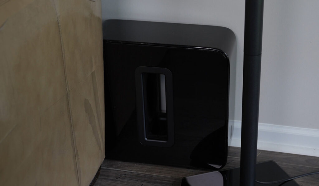Sonos Subwoofer behind a living room couch
